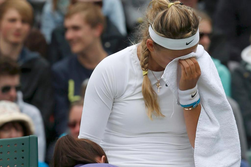 Victoria Azarenka is in pain, but hit back to win through in straight sets.