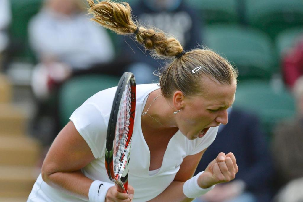 Petra Kvitova celebrates in style after securing a first round victory at Wimbledon.