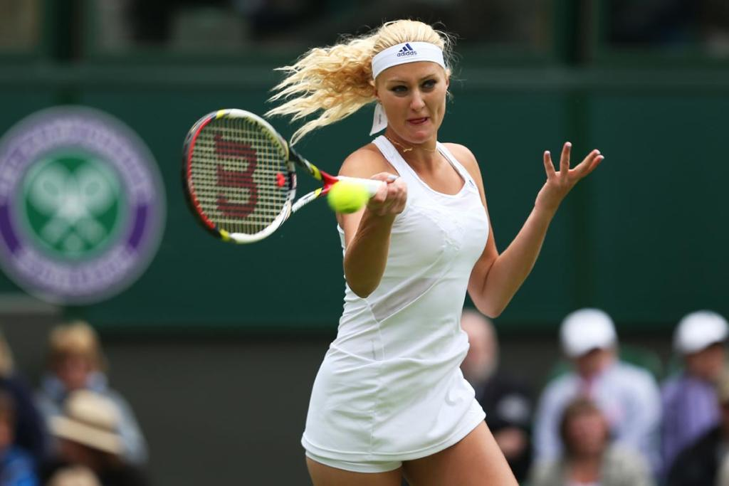 Kristina Mladenovic plays a forehard - but her Wimbledon adventure didn't last long against Maria Sharapova.