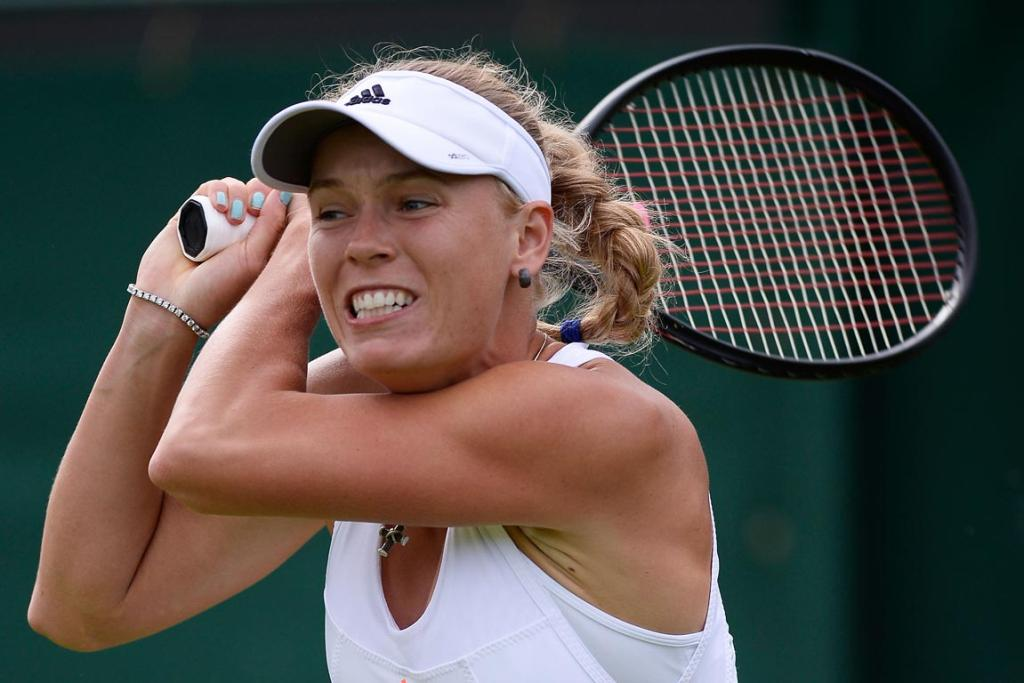 Caroline Wozniacki fared better than boyfriend Rory McIlroy has over the last few months with first-round victory at Wimbledon.