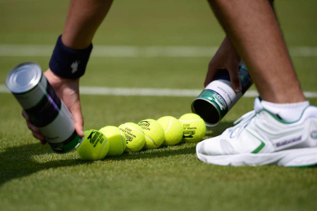 A ball boy lays out new balls at Wimbledon.
