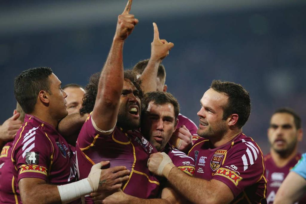 Sam Thaiday is mobbed by Queensland team-mates after opening the scoring.