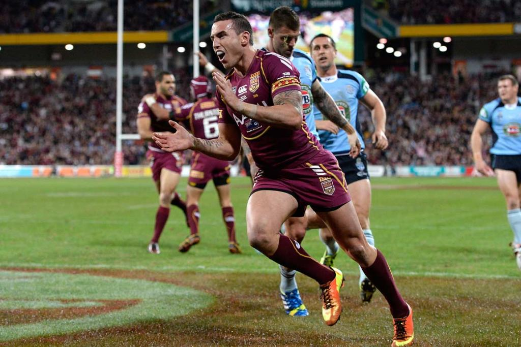 Darius Boyd celebrates his first try, that gave Queensland a 14-0 lead.