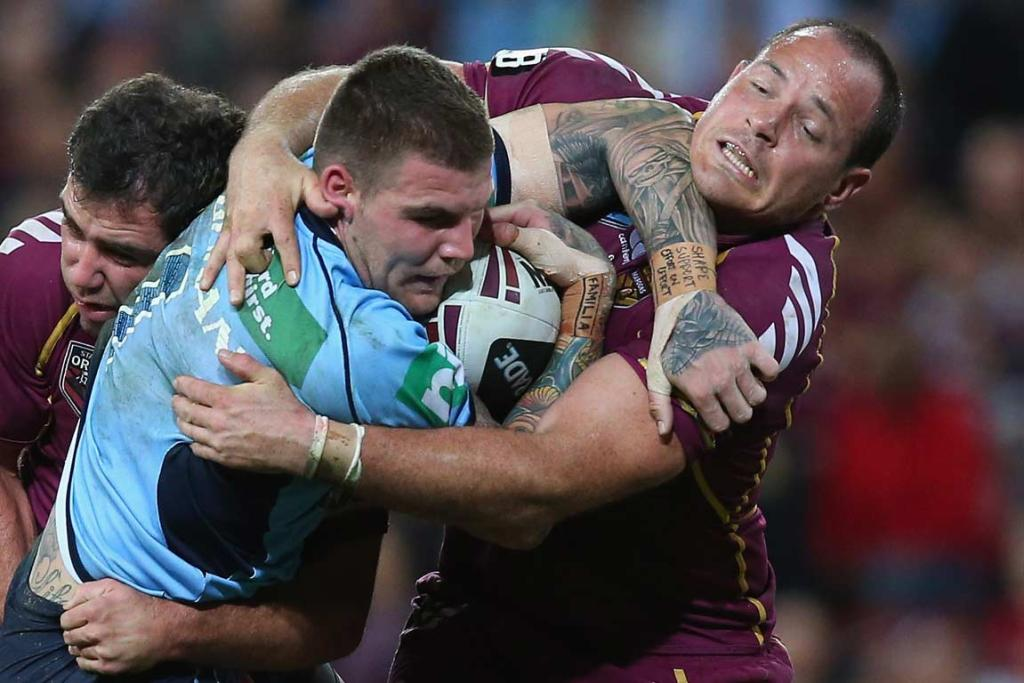 Josh Dugan gets a forearm into Matthew Scott's chin as he attempts to break a tackle.