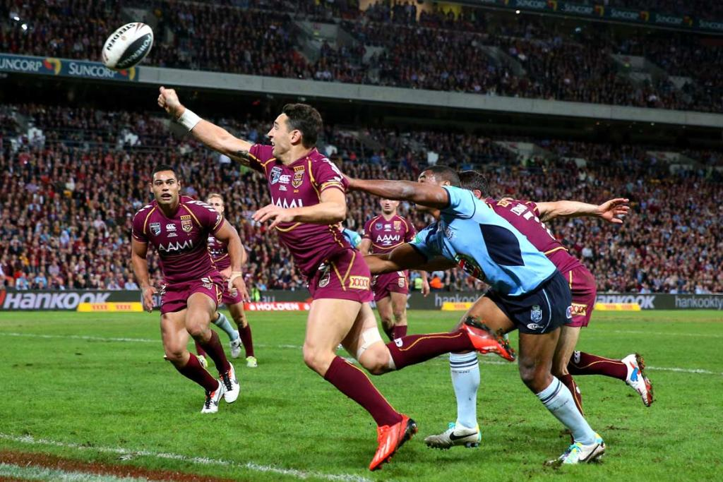 Billy Slater knocks the ball out of play during the second half.