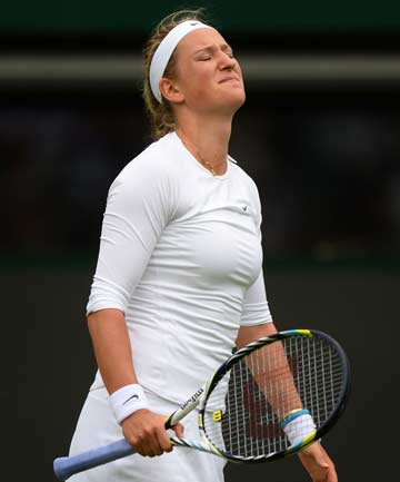 KNEE ISSUE: Victoria Azarenka grimaces during her first round victory over Maria Joao Koehler of Portugal. She was forced to withdraw with a knee injury before her second round match.