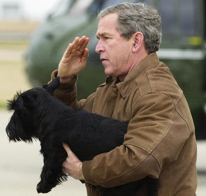 Former President George W Bush and his dog Barney.