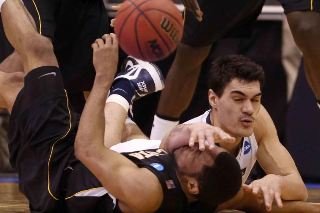 Steven Adams battles with Wichita State's Tyreke Cotton for a loose ball.
