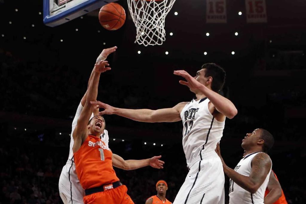 Steven Adams attempts unsuccessfully to block a shot against Syracuse.