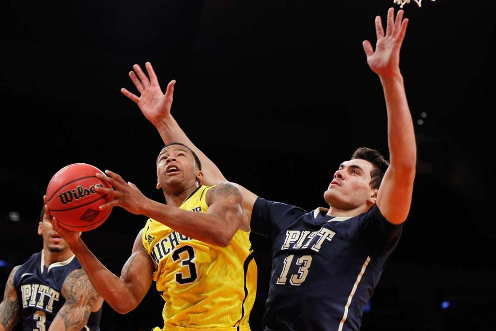 Steven Adams bodies up against Michigan's Trey Burke, who is expected to be a top-10 pick in the NBA draft.