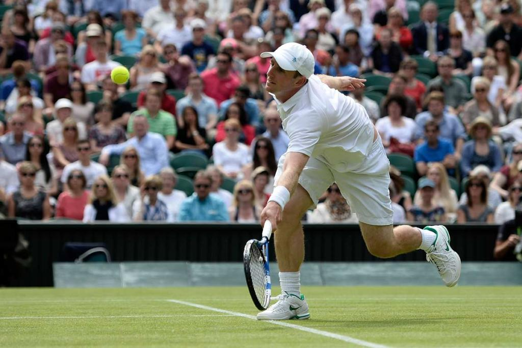 Jesse Levine of Canada stretches to hit a volley against Juan Martin del Potro.