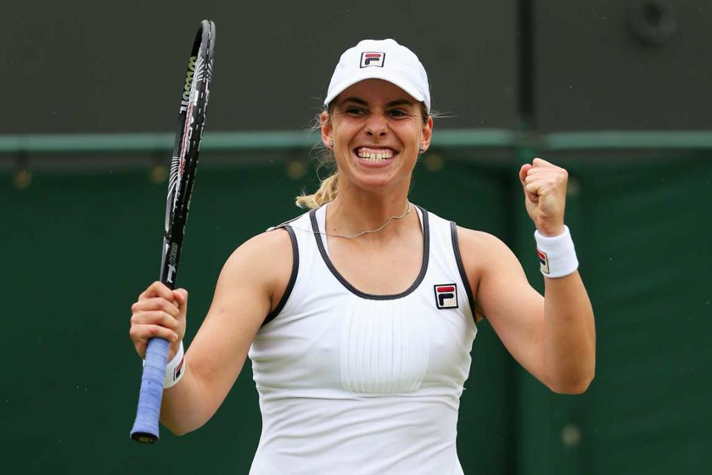 Marina Erakovic pumps her fists after upsetting 24th seed Peng Shuai in the second round at Wimbledon.