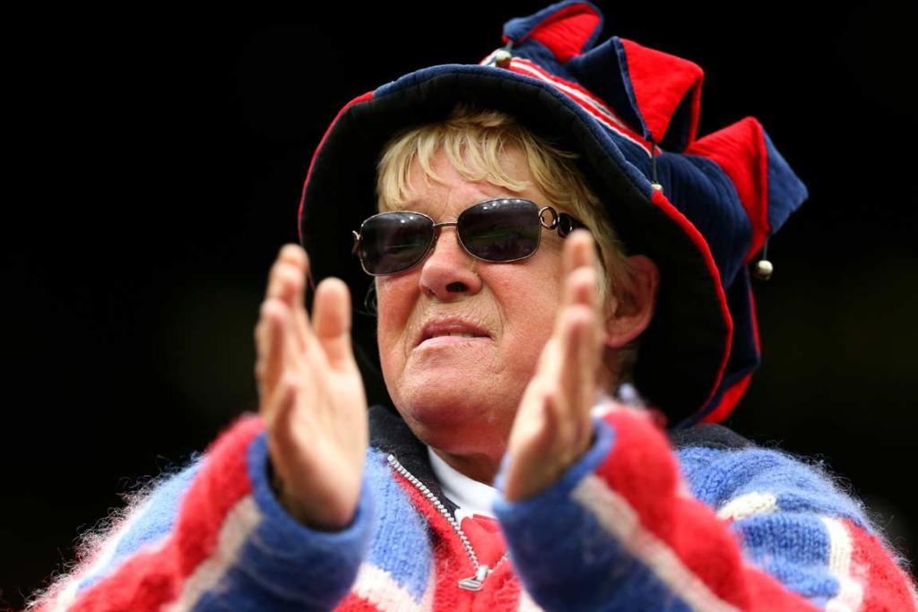 A spectator in Union Jack clothing cheers on Laura Robson.