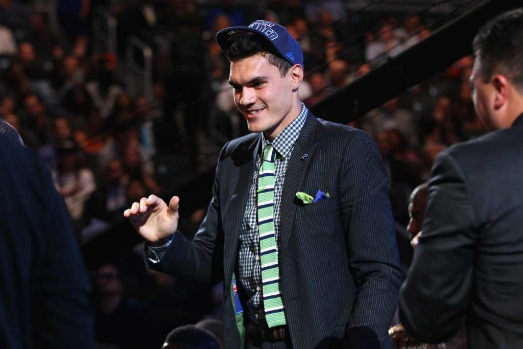 Steven Adams reacts after being announced as the 12th pick by the Oklahoma City Thunder in the NBA Draft.
