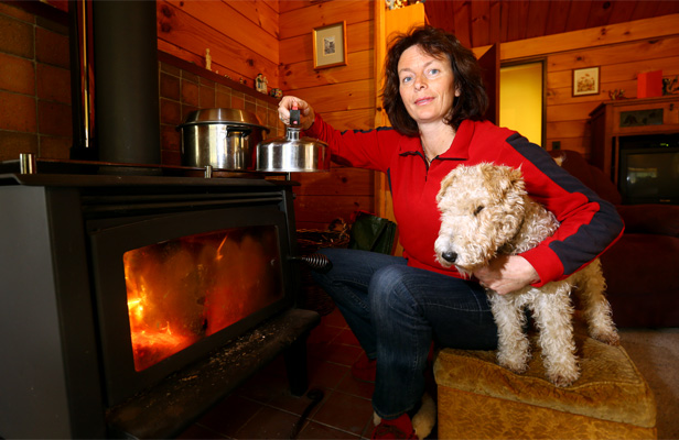 TIME ON HER HANDS: Helen Down runs a business from her home in Upper Hutt, so was relieved to get power back on after three days, but is not happy with Contact Energy's communications.