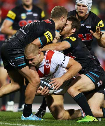 HEAD-TO-HEAD: Two Penrith Panthers players clash heads as St George-Illawarra's Jack de Belin squeezes through to score in their NRL match. The Panthers won 25-10.