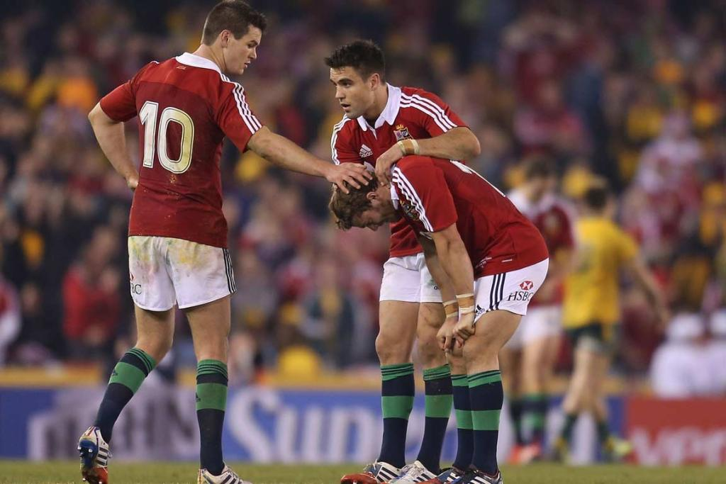 Leigh Halfpenny is consoled by Jonathan Sexton (left) and Sean Maitland after his extra-time penalty to win fell short.