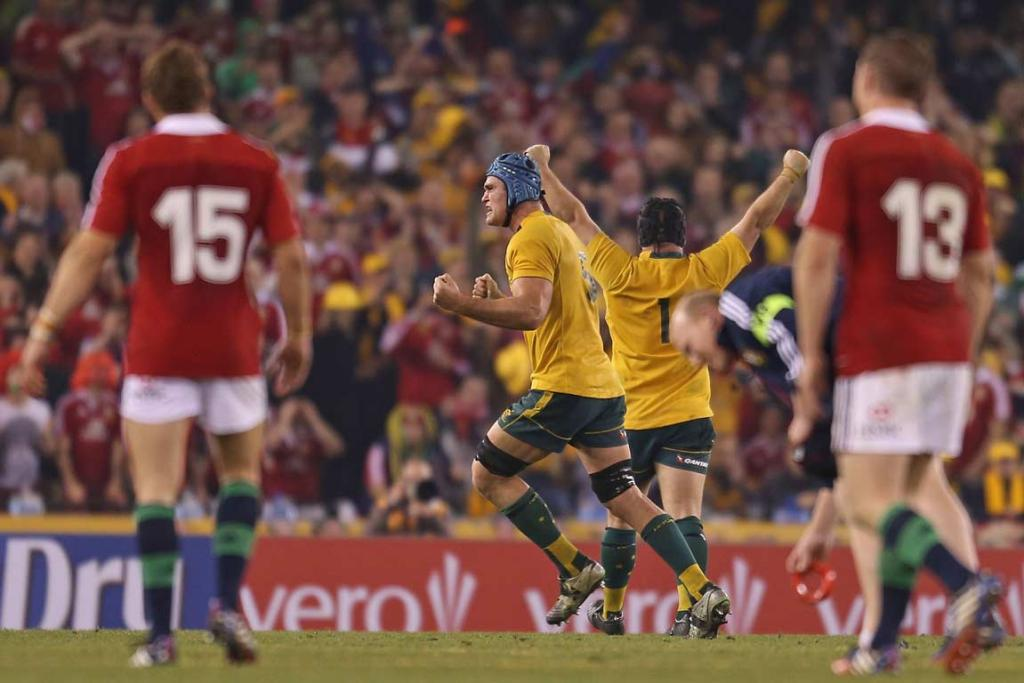 Wallabies players James Horwill and Benn Robinson celebrate as Leigh Halfpenny's kick misses.