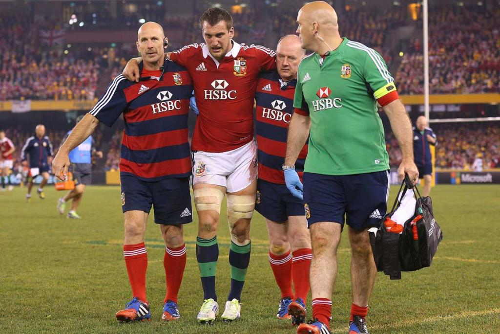 Lions captain Sam Warburton is helped from the field during the second test.