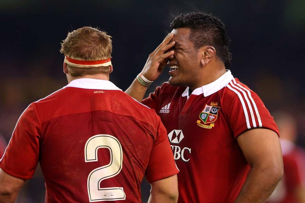Mako Vunipola wipes his face during a break in play.