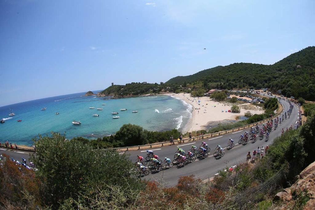 Riders head past a beach in Porto Vecchio on the island of Corsica.