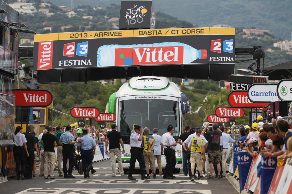 The Orica-Greenedge team bus collides with the finishing banner prior to the race arriving at the end of stage one.