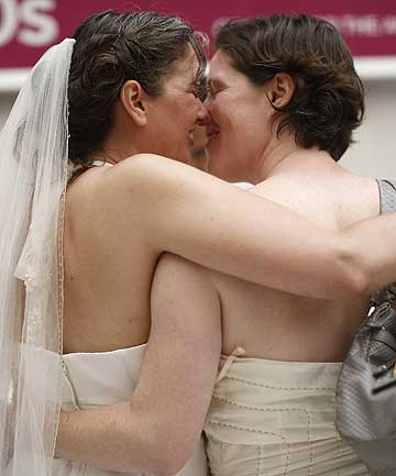 Same-sex couple Cynthia Wides (left) and Elizabeth Carey embrace each other as they turn in their marriage license at City Hall in San Francisco on June 29, 2013.