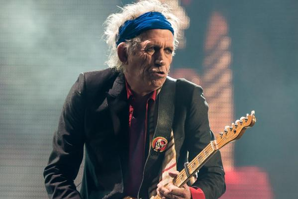 Keith Richards of The Rolling Stones performs on the Pyramid Stage during day three of the 2013 Glastonbury Festival at Worthy Farm.