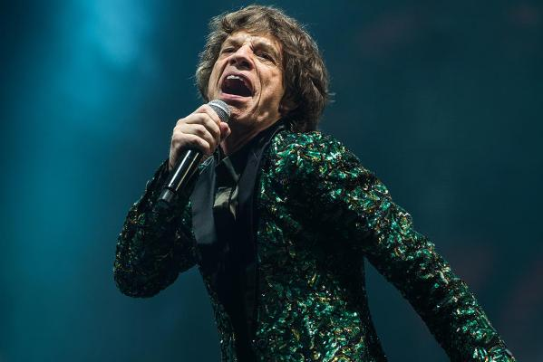 Sir Mick Jagger of The Rolling Stones performs on the Pyramid Stage during day three of the 2013 Glastonbury Festival at Worthy Farm.