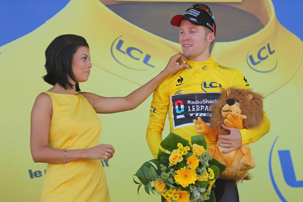 Jan Bakelants of Belgium and Radioshack Leopard celebrates on the podium as he wears the yellow jersey after winning stage two.