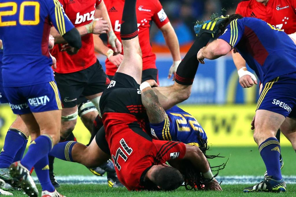 Tom Marshall of the Crusaders is dumped by Ma'a Nonu of the Highlanders during the round 18 Super Rugby match between the Highlanders and the Crusaders.