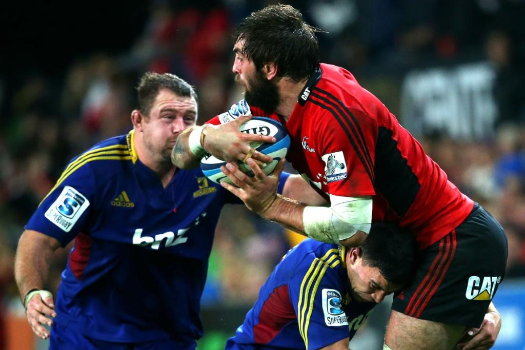 Sam Whitelock of the Crusaders is tackled by Kade Poki of the Highlanders during the round 18 Super Rugby match between the Highlanders and the Crusaders.