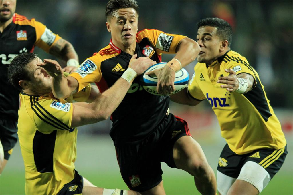 Tim Nanai-Williams attempts to bust through the Hurricanes defence.