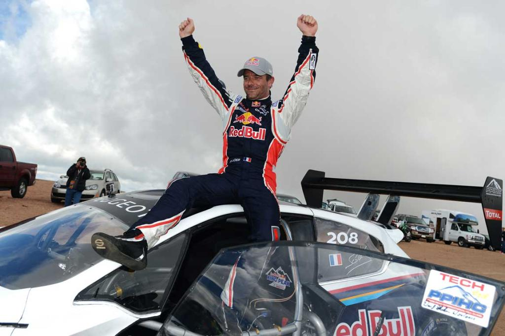 Sebastien Loeb, of France, celebrates after setting a record time of 8:13.87 during the Pikes Peak International Hill Climb Colorado Springs, Colorado.
