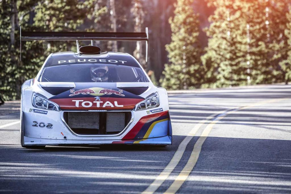 Sebastien Loeb, of France, drives his Peugeot during a practice run for the Pikes Peak International Hill Club at Colorado Springs.
