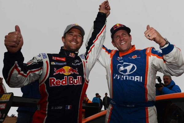 Sebastien Loeb (left) and Rhys Millen celebrate after the Pikes Peak International Hill Climb  in Colorado Springs, Colorado. Loeb won the race with a record time of 8:13.87 and Millen finished second in 9:02:19.