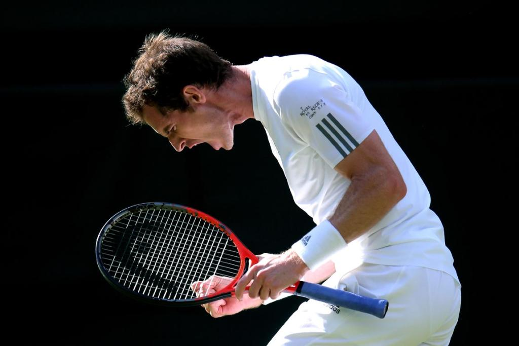 Andy Murray of Great Britain celebrates match point during the Gentlemen's Singles fourth round match against Mikhail Youzhny of Russia on day seven of Wimbledon.