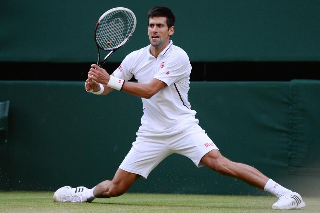 Novak Djokovic of Serbia in action during the Gentlemen's Singles fourth round match against Tommy Haas of Germany on day seven of Wimbledon.