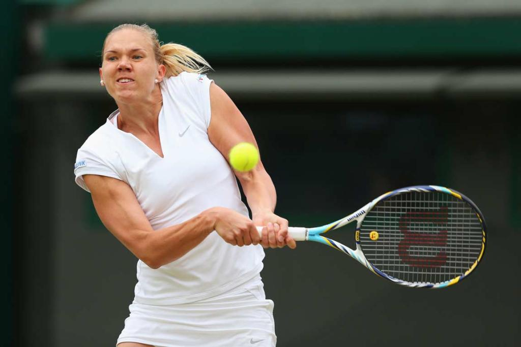 Estonian Kaia Kanepi plays a no-look backhand.