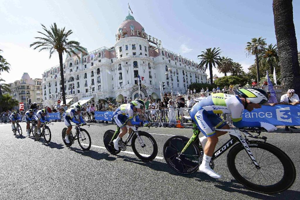 Orica GreenEdge riders head along the Promenade de Anglais during the team time-trial during stage four of the Tour de France.