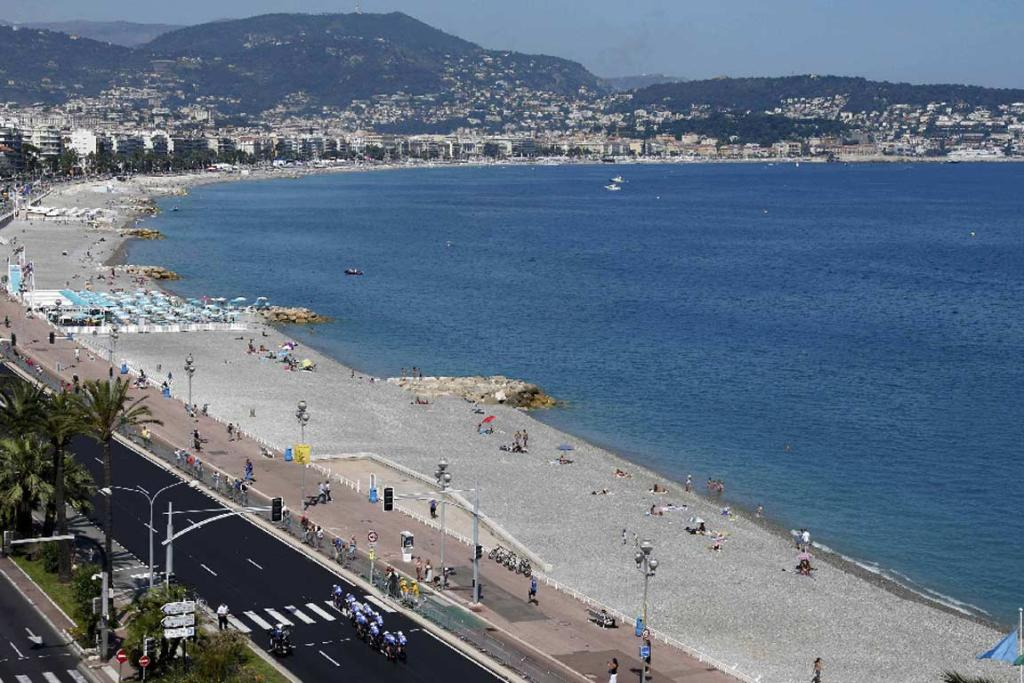 Riders head along Promenade de Anglais in Nice.