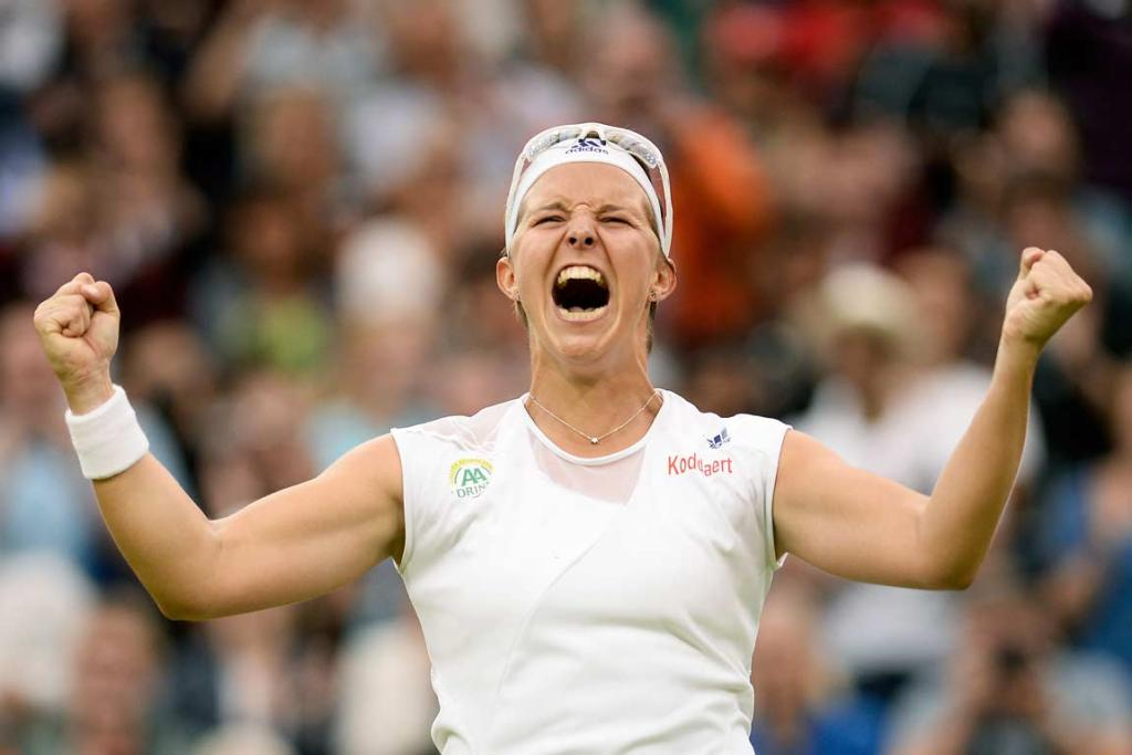 Belgian Kirsten Flipkens reacts after upsetting Petra Kvitova to reach the semifinals.