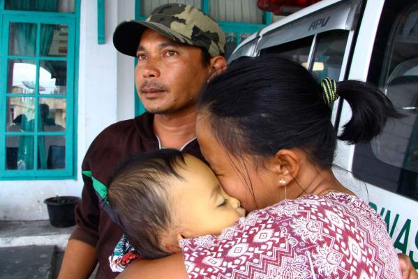 Woman with child killed in Indonesia earthquke