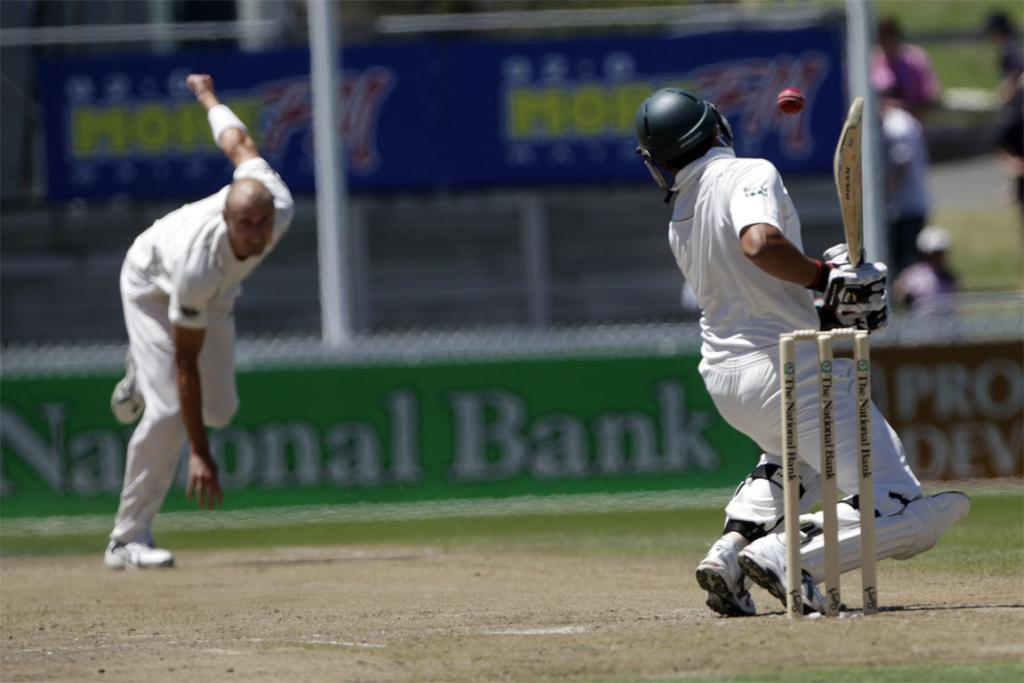 Chris Martin bowls a bouncer to Pakistan's Azhar Ali during the first test at Seddon park in Hamilton on 2011.