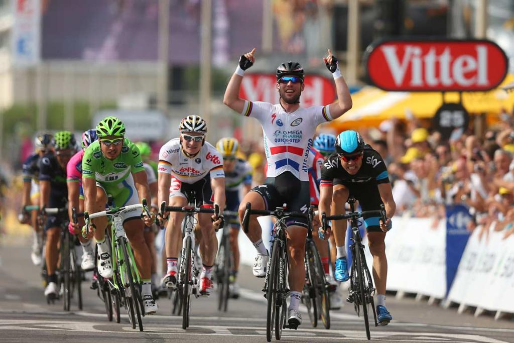Mark Cavendish celebrates as he crosses the line to win stage five of the 100th Tour de France.