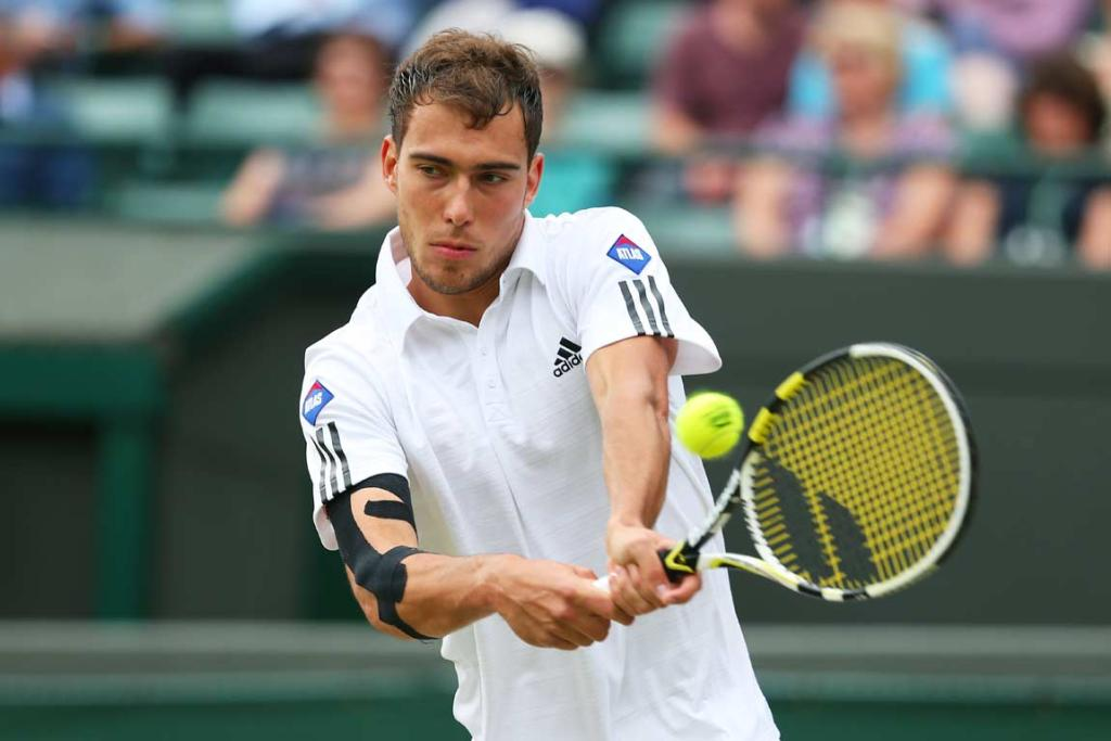 Jerzy Janowicz plays a backhand shot during his quarterfinal against Lukasz Kubot.