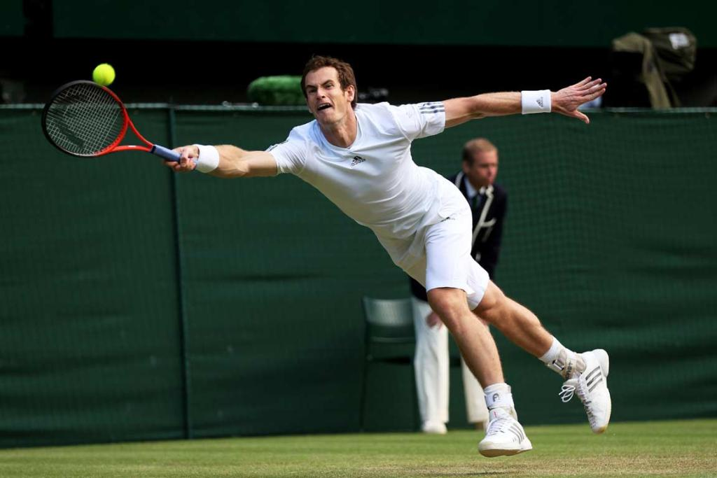 Andy Murray stretches full-length to reach a ball against Fernando Verdasco.