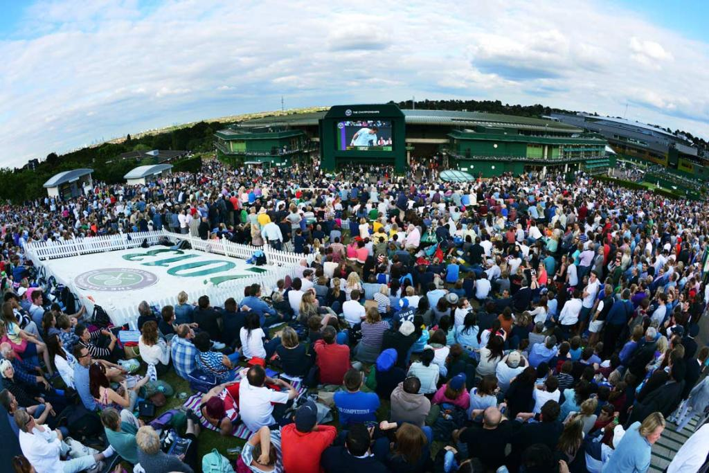 Spectators on 'Murray Mound' watch Andy Murray play Fernando Verdasco on the big screen.