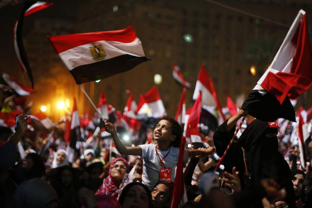 Protesters against Egyptian President Mohamed Morsi celebrate after the military effectively declared his removal.
