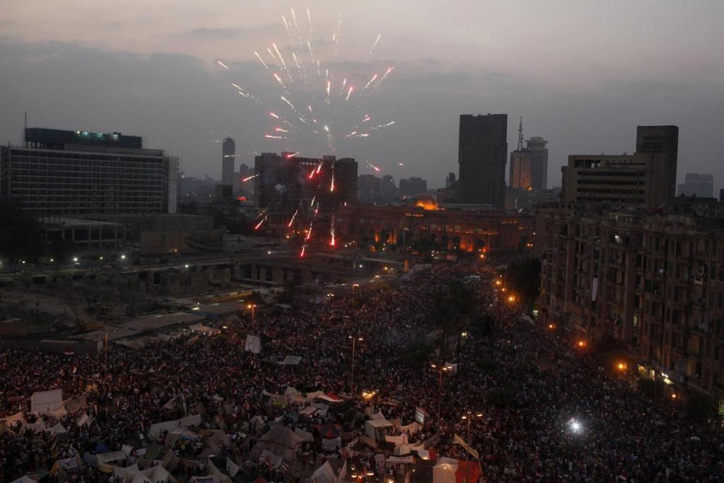 Fireworks go off as protesters, who are against Egyptian President Mohamed Morsi, gather in Tahrir Square in Cairo.